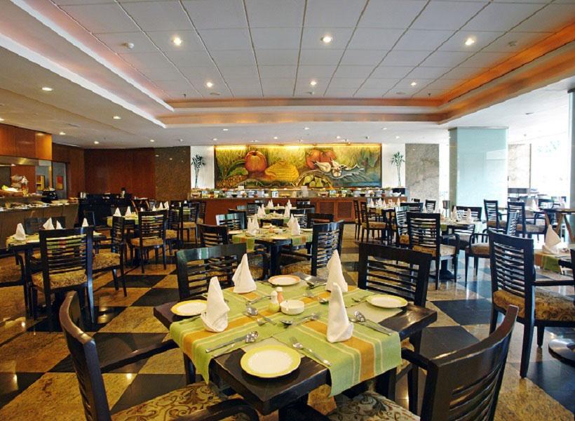 5 star hotels near bangalore international airport lalit bangalore for 5 star restaurant exterior